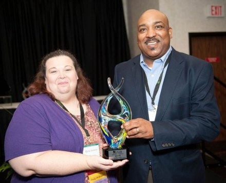 Social work students and the School of Social and Behavioral Sciences at the University of Arkansas at Monticello were recently honored at the state conference of the NationalAssociation of Social Workers (NASW) held recently in North Little Rock. UAM was recognized for winning a statewide competition for the largest increase in NASW membership. Pictured receiving the award are Andre Lewis (right), director of the social work program and assistant professor of social work at UAM, and Marie Jenkins, assistant professor of social work and field education director for the school's social work program.  (Photo Courtesy of Media Services)